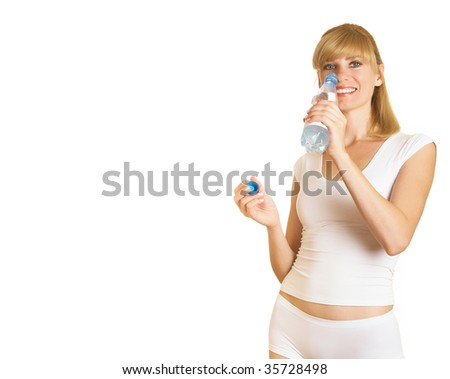 Young girl with bottle of water on isolated