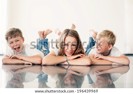 young girl with brothers at home