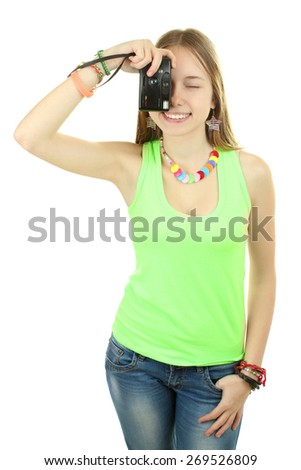 young girl with camera in hand taking pictures - stock photo