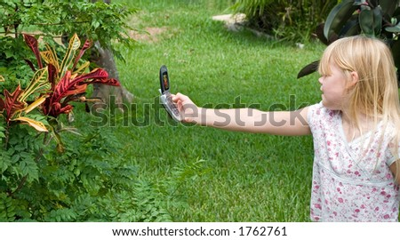 Young girl with camera phone - stock photo