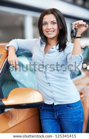 Young girl with car keys - stock photo