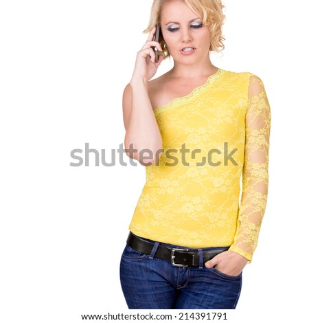 Young girl with cellphone over white background - stock photo
