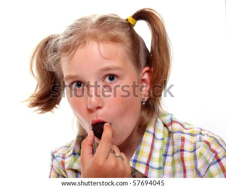 Young girl with chocolate candy. - stock photo