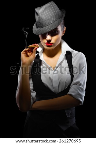 Young girl with cigar on black - stock photo