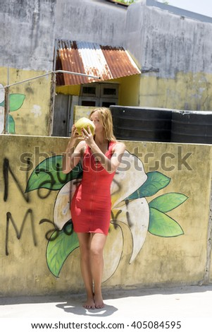 young girl with coconuts - stock photo