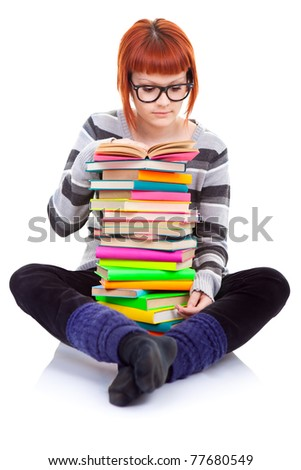 young girl with color pile of books reading