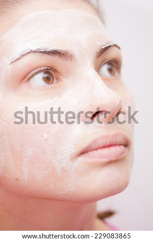 young girl with cream on her face