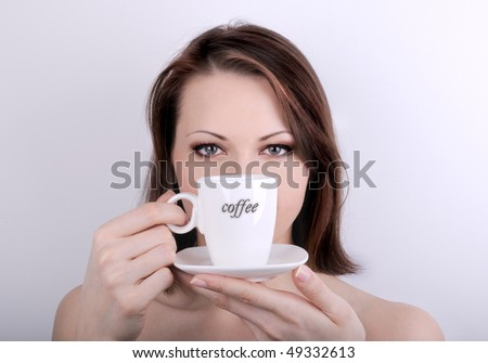 Young girl with cup of coffee - stock photo