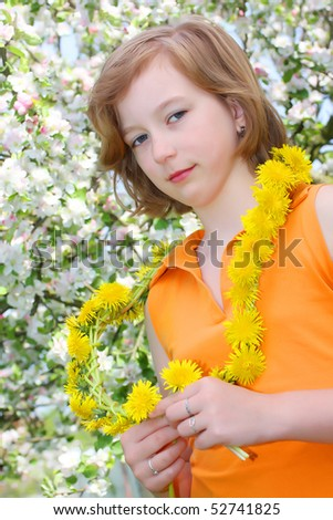 Young girl with dandelion necklace. Portrait with shalow DOF. - stock photo