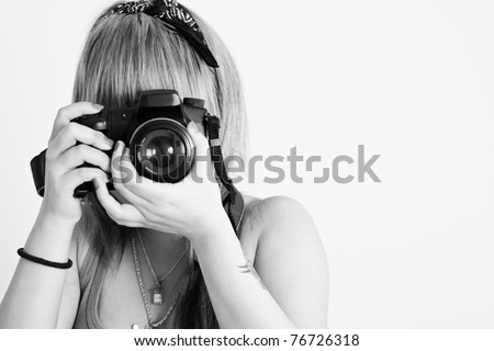 Young Girl with digital camera, taking a picture - stock photo