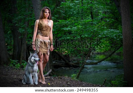 Young girl with dog in forest - stock photo