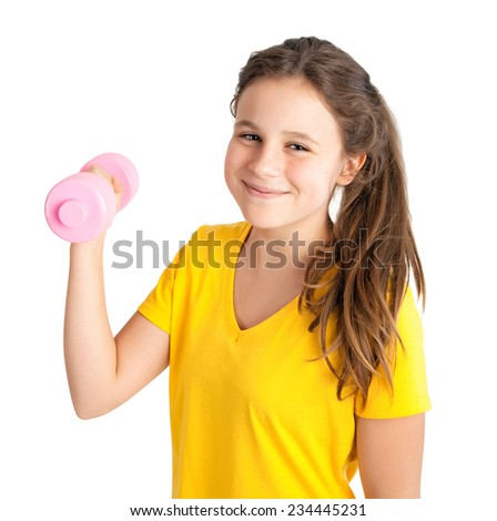 young girl with dumbbell - stock photo