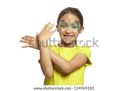 Young girl with face painting butterfly smiling on white background - stock photo