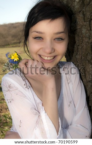 Young Girl with flowers in spring - stock photo