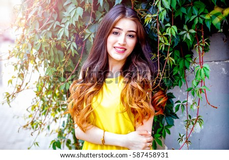 young girl with flowers summer in yellow dress