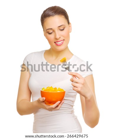 Young girl with fruit salad isolated - stock photo