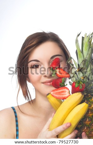 Young girl  with fruits in her hands - stock photo