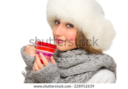 Young girl with fur hat and mug isolated - stock photo
