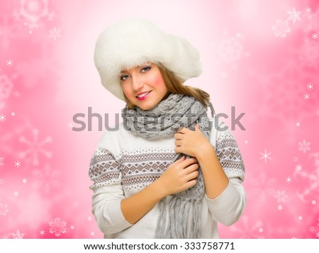 Young girl with fur hat on winter background - stock photo