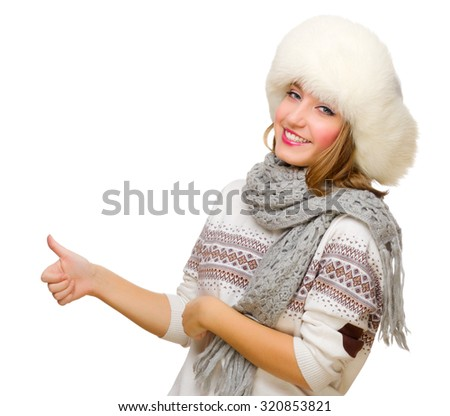 Young girl with fur hat shows ok gesture isolated
