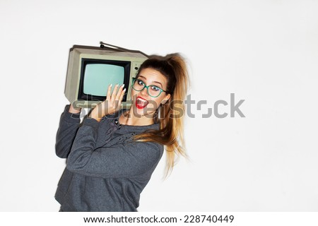 young girl with glasses and a hipster with a retro TV in chickens smiles and laughs - stock photo
