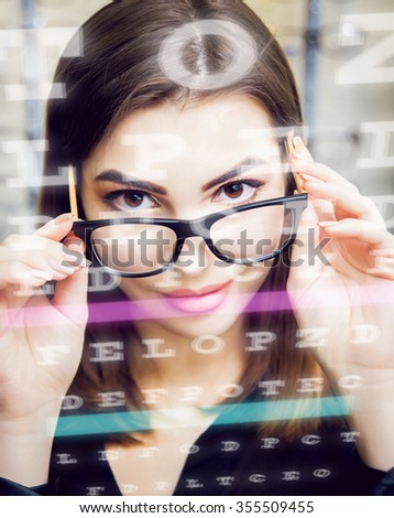 Young girl with glasses on the light background