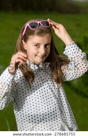 Young girl with glasses outdoor - stock photo
