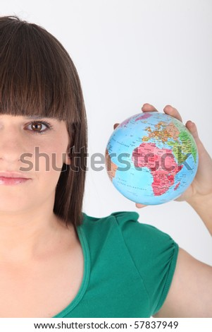 Young girl with globe