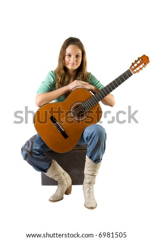 Young girl with guitar. Isolate on white.