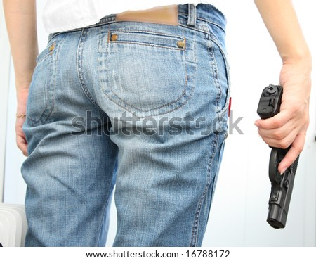 Young girl with gun in hand - stock photo