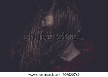 Young girl with hair flying, concept nightmares - stock photo