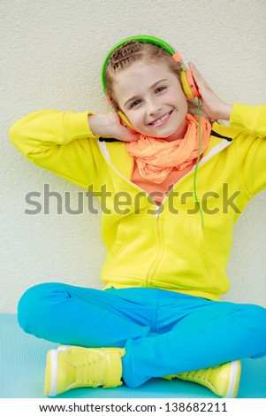 Young girl with headphones enjoying music . Lifestyle of young people concept. - stock photo