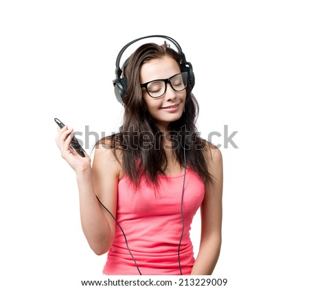 Young girl with headphones on white background  - stock photo