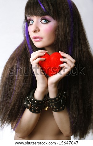 young girl with heart and lock - stock photo