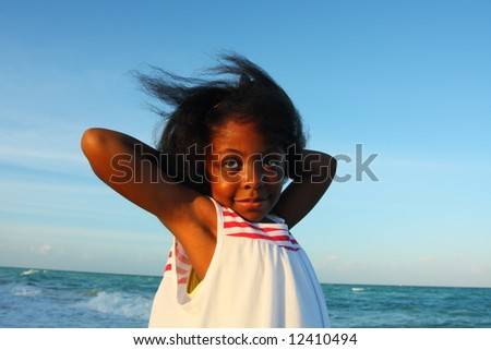 Young girl with her arms behind her head - stock photo