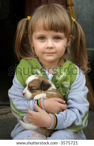 Young girl with her dog - stock photo