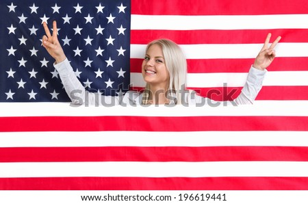 Young girl with her mouth sealed over American flag background - stock photo