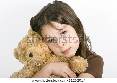 Young Girl with her Teddybear - stock photo