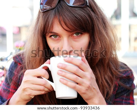 young girl with in outdoor cafe - stock photo
