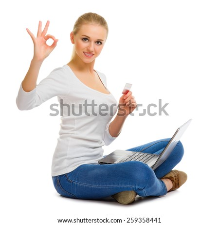 Young girl with laptop and plastic card isolated - stock photo
