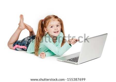Young girl with laptop. Isolated on white background. Smiling and pointing at laptop computer.