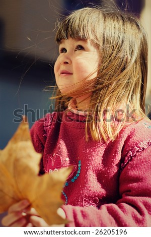 young girl with leaf maple