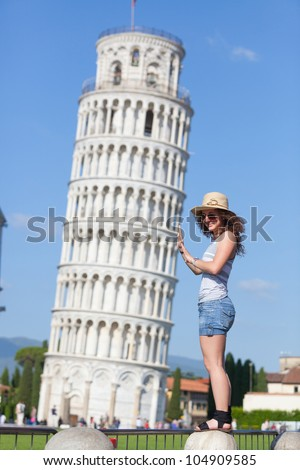 Young Girl with Leaning Tower of Pisa - stock photo