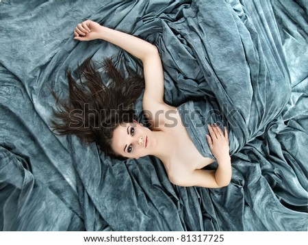 Young girl with long black hair lying poses