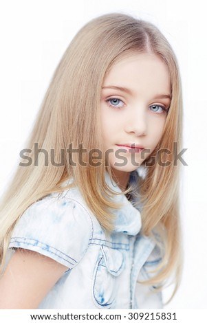 Young girl with long blond hair and blue eyes isolated on white background. - stock photo