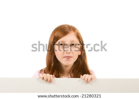 Young girl with long hair wearing glasses holding a blank sign. Isolated on white. Extra white space with your message can be added to the bottom side of the picture - stock photo