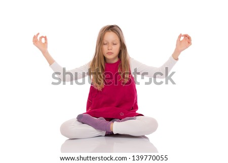 Young girl with long hair wearing red dress and making yoga exercises. Isolated on white background. - stock photo