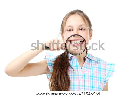 Young girl with magnifying glass on a white background - stock photo