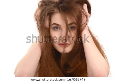 Young girl with messy long brown hair. Bad hair day.  - stock photo
