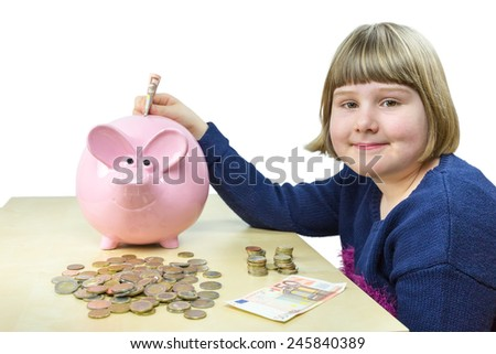 Young girl with money and piggy bank isolated on white background - stock photo